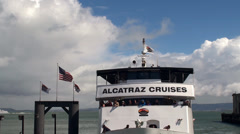 "Ferryboat of ""Alcatraz Cruises"" with tourists is leaving the Pier 33 Stock Footage"
