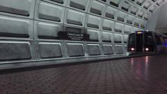 Metro emerges tunnel, passes frame.  4k - stock footage