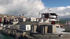 Tourists are at the Diorama of Alcatraz island. Pier 33 of Alcatraz Cruises. - stock footage