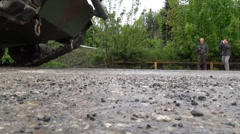 Low angle view of abrams tank treads in motion Stock Footage