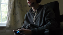 Gamer engrosses himself with video games Stock Footage