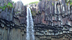 Brink of small waterfall on volcanic basalts Stock Footage