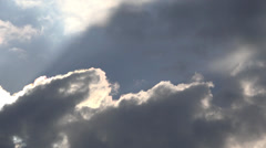 Sun behind the clouds, dramatic sky, natural phenomenon  Stock Footage
