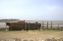 Abandoned river barge - stock photo