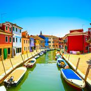 Venice landmark, burano island canal, colorful houses and boats, italy Stock Photos