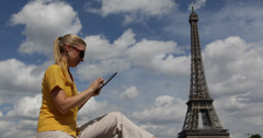 Ultra HD 4K UHD Business woman work digital tablet Eiffel Tower surfing online  Stock Footage