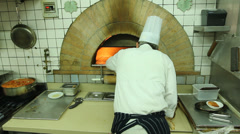 Chef baking Pizza in Oven_4 clips Stock Footage