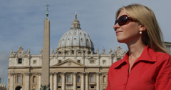 Ultra HD 4K UHD Portrait tourist woman enjoy admire Vatican church basilica dome - stock footage
