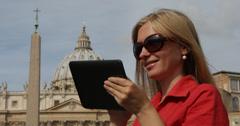 Ultra HD 4K Beautiful woman work Vatican Basilica church dome digital tablet Stock Footage