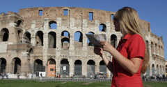 Ultra HD 4K Young tourist woman female check direction map Colosseum Wall Rome Stock Footage
