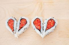 love sushi concept with four pieces of sushi forming the two hearts - stock photo