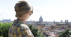Ultra HD 4K Beautiful woman blonde female cityscape relax historic skyline  Stock Footage