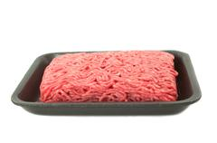 a tray of fresh lean ground beef from supermarket isolated on white backgroun - stock photo
