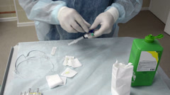 Nurse prepares an injection for Sclerotherapy procedure Stock Footage
