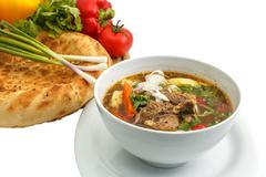Kharcho soup with bread and vegetables Stock Photos