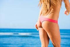 Beautiful woman on tropical beach Stock Photos