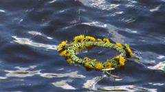 A wreath of flowers on the water Stock Footage