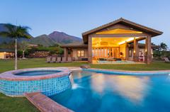 luxury home with swimming pool at sunset - stock photo