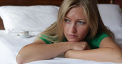 4K Sad woman cry lying luxury bed adult girl depressed pain grief sorrow tear Stock Footage