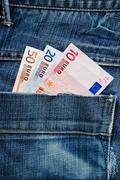Euros in pocket - stock photo