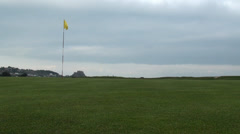 Golf Course Hole, Green Grass & Yellow Flag Stock Footage