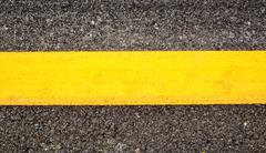 Road asphalt texture and background with yellow line Kuvituskuvat