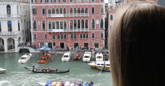 Ultra HD 4K blonde woman admire window Venice Italy city traffic gondola Canal Stock Footage