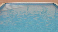 Empty and sunny swimming pool Stock Footage
