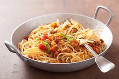 Cooking italian pasta spaghetti bolognese Stock Photos