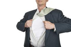 Businessman showing blank superhero suit underneath his shirt standing Stock Illustration
