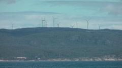 Wind turbines over sea - stock footage
