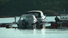 Boats moored by floating pontoon Stock Footage