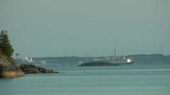 Merchant Ship in distance Stock Footage