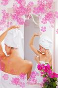 beautiful gilr applying anti-perspirant after shower - stock illustration