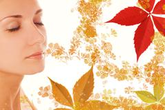 Beautiful girl's face and colorful autumn leaves around her Stock Illustration