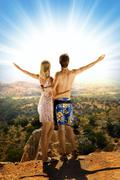 An attractive couple relaxing in high mountains Stock Illustration