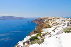 Oia, traditional greek village and Aegan sea, Greece Stock Photos