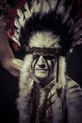 american indian chief with big feather headdress - stock photo