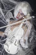 instrument, beautiful woman with couture gown in white, violin, music concept - stock photo