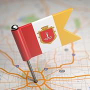 Odessa Small Flag on a Map Background. Stock Illustration