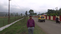 A man posing on a lonely roadside at Jharnapani, Medziphema, Nagaland Stock Footage
