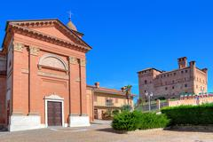 Church and medieval castle in small italian town. Stock Photos