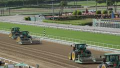 Tractors Grooming Track at Horse Racetrack Stock Footage