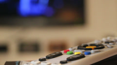 TV Remote In Front of Television Stock Footage