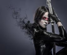 brunette with katana sword, fineart concept - stock photo