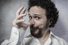 Joke, decisionmaking, man in white shirt with funny expressions Stock Photos