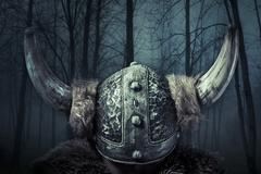 helmet, viking warrior, male dressed in barbarian style with sword, bearded - stock illustration