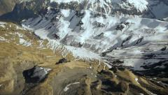 fly over snowcapped mountain panorama. winter landscape. alps glaciers - stock footage