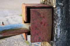 close up old boundary gate lock for security - stock photo