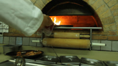 Stove used chiefly for baking bread and pitta or bake Pizza Wood Fired Oven Stock Footage